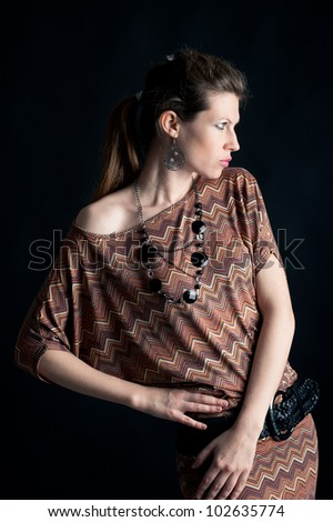Portrait of beautiful girl with vintage dress against black background.