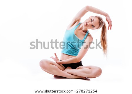 portrait of beautiful girl working out yoga exercise, isolated on white background - stock photo