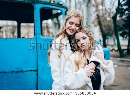 Portrait of beautiful girls in fashionable clothes