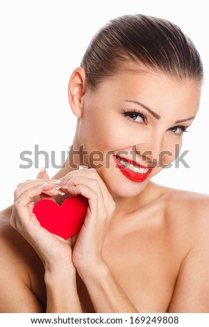 Portrait of Beautiful gorgeous smiling woman with glamour bright makeup and red heart in hand - stock photo