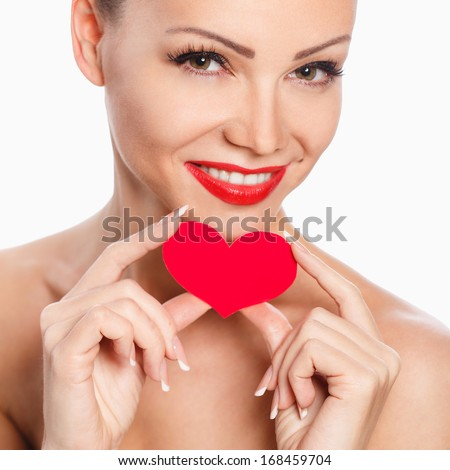 Portrait of Beautiful gorgeous woman with glamour bright makeup and red heart in hand - stock photo