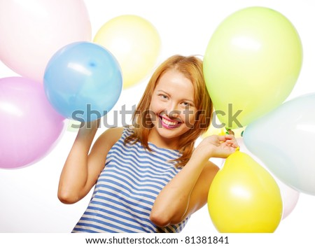 portrait of beautiful happy girl with balloons