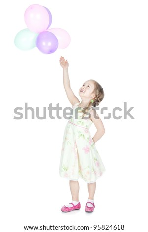Portrait of beautiful happy little girl with colorful balloons over white - stock photo