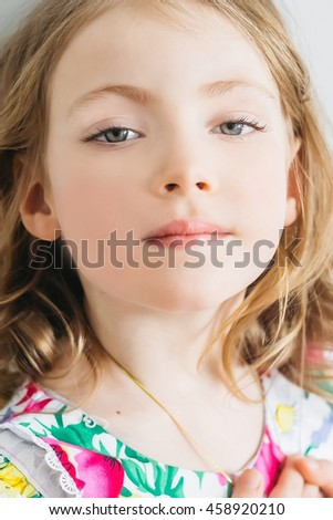 Portrait of beautiful happy little girl with with grey eyes - stock photo