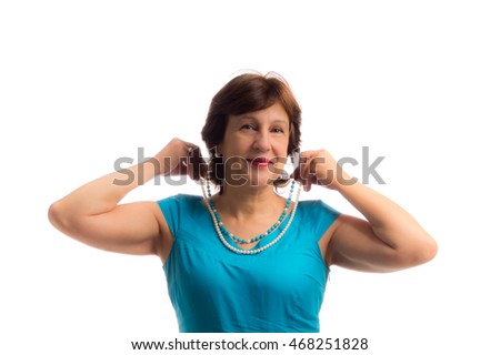 Portrait of beautiful happy mature woman wigh bead string in hands isoladed on white
