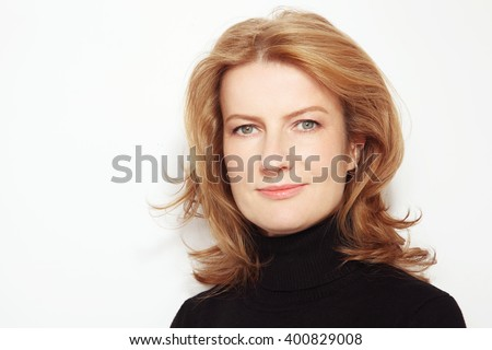 Portrait of beautiful happy smiling mature woman with curly hair and clean make-up - stock photo