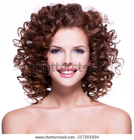 Portrait of beautiful happy smiling woman with brunette curly hair - isolated on white background. - stock photo