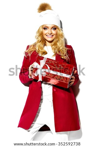 portrait of beautiful happy sweet smiling blonde woman girl holding in her hands big Christmas gift box in casual red hipster winter clothes - stock photo