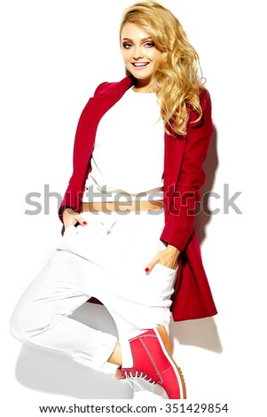 portrait of beautiful happy sweet smiling blonde woman girl in casual hipster warm winter clothes, in red jacket