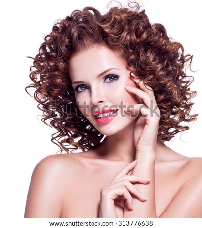 Portrait of beautiful happy woman with brunette curly hair posing at studio - isolated on white.  - stock photo