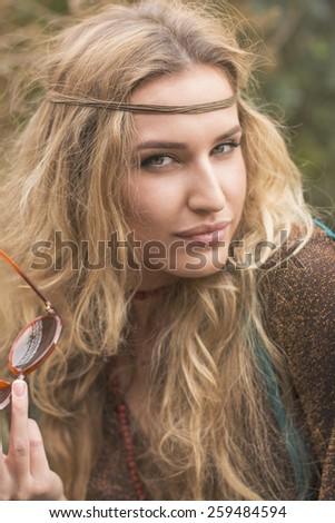 portrait of beautiful hippie girl outdoors - stock photo