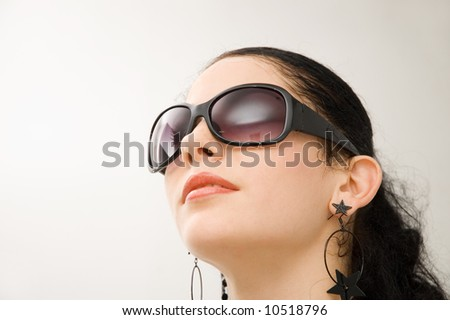 Portrait of beautiful hispanic model with dark sunglasses