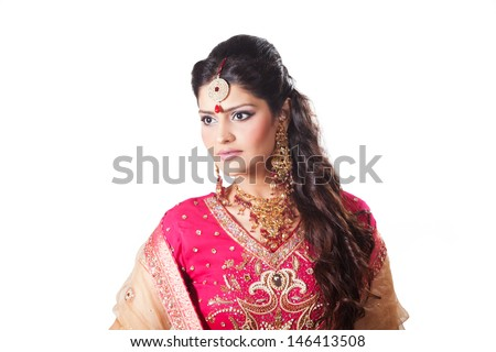 portrait of beautiful Indian bride, Indian bride in red dress - stock photo