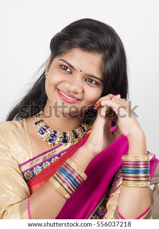 Portrait of beautiful indian girl , Happy young beautiful traditional Indian woman in traditional saree.