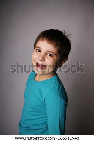 Portrait of beautiful joyful kid, studio shot - stock photo
