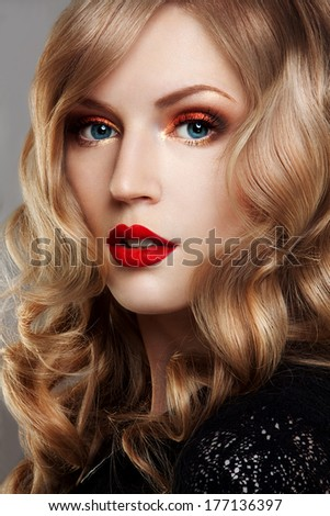 Portrait of beautiful lady with bright make-up. Red lips.