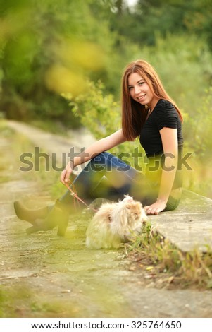 Portrait of beautiful lady with rabbit