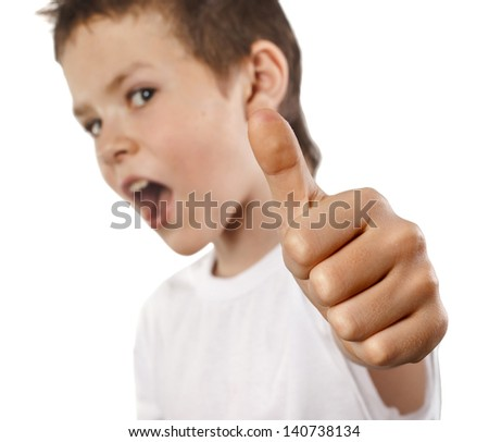Portrait of beautiful little boy giving you thumbs up isolated over white background - stock photo