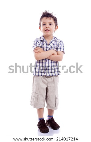 Portrait of  beautiful little boy standing with arms crossed on white background - stock photo