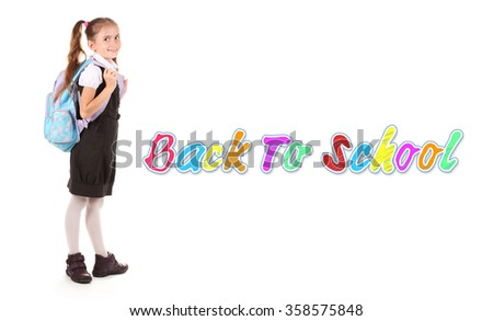 Portrait of beautiful little girl in school uniform with backpack isolated on white - stock photo