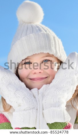 portrait of beautiful little girl in warm clothing outdoors - stock photo
