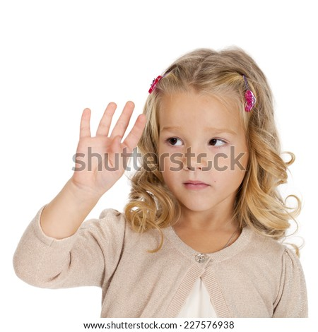 Portrait of beautiful Little girl showing four fingers - stock photo
