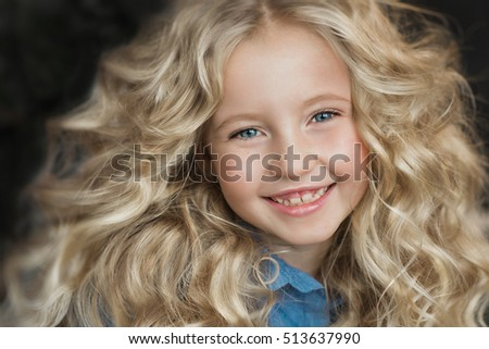 Portrait of beautiful little girl smiles