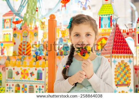 Portrait of beautiful little girl with beautiful eyes and smiling at camera - stock photo
