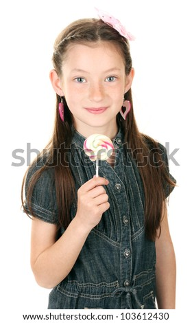 Portrait of beautiful little girl with lollipop isolated on white - stock photo