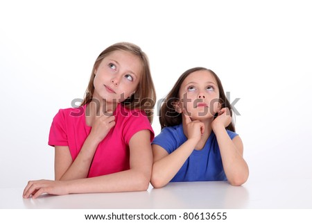 Portrait of beautiful little girls with thoughtful look - stock photo