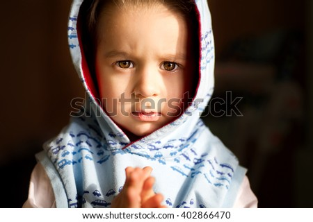 Portrait of beautiful little thoughtful and serious l boy. - stock photo