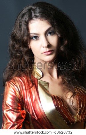 Portrait of beautiful looking woman brunette on dark - stock photo