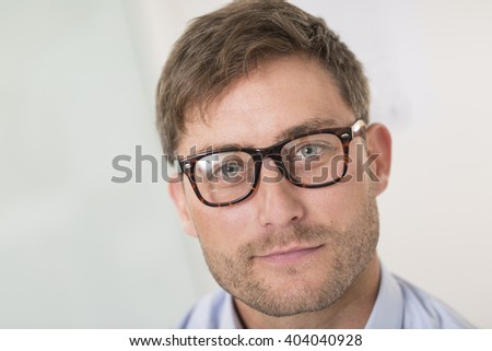 Portrait of beautiful man with glasses