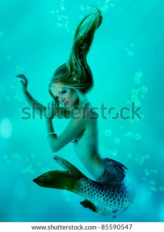 portrait of beautiful mermaid girl with fish tail and long blond hair magic mythology being original photo compilation - stock photo