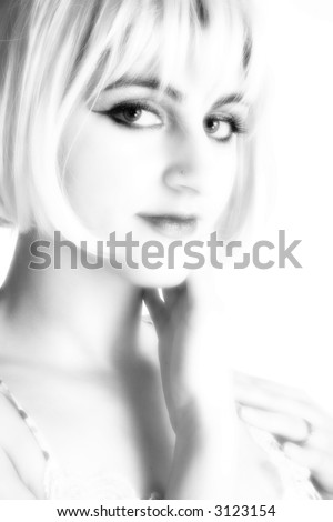 Portrait of beautiful Middle Eastern woman in black and white with blonde hair.