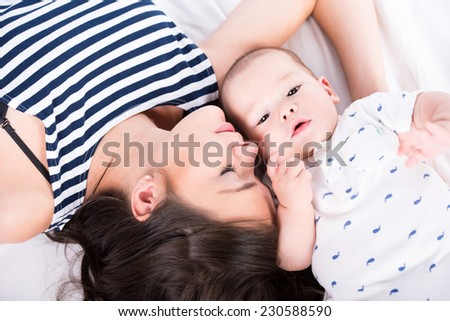 Portrait of beautiful mother and adorable baby. Happy family. - stock photo