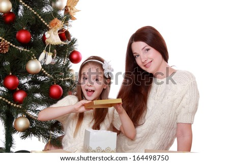 Portrait of beautiful mother and little girl having fun time on Christmas on Holiday theme/Beautiful smile woman ang lovely little girl - stock photo