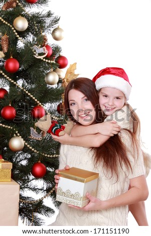 Portrait of beautiful mother and little girl having fun time on Christmas on Holiday theme/Beautiful smile woman and lovely little girl as a familey spending free time and enjoy it on Holiday theme - stock photo