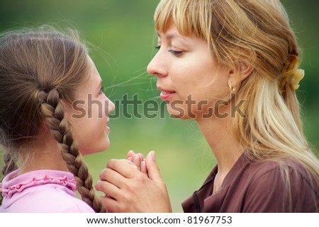 Portrait of Beautiful mother with girl outdoors