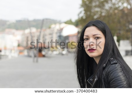 Portrait of beautiful multiracial woman with piercing.