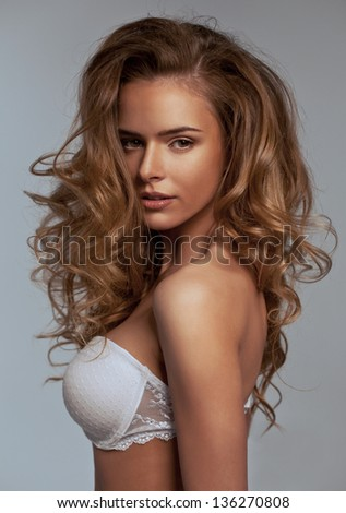 Portrait of beautiful natural woman with long hair - stock photo