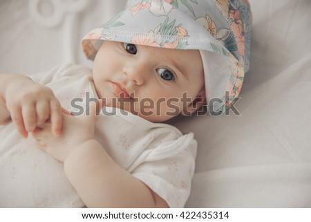 portrait of beautiful newborn girl.  Closeup Portrait. Toned in soft color. Studio shot, Horizontal  - stock photo