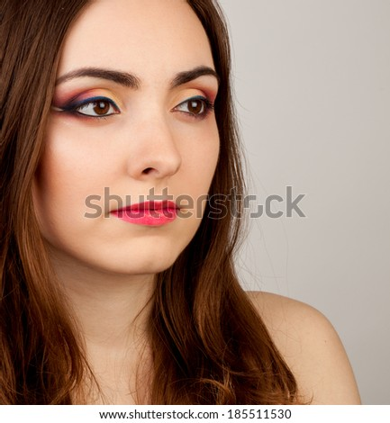 Portrait of beautiful nude woman with creative make-up - stock photo