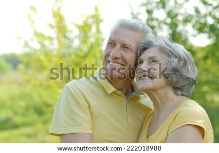 Portrait of beautiful old people embracing outdoors on the walk