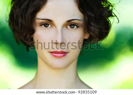 Portrait of beautiful polish girl close up on green background. - stock photo