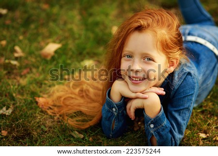 portrait of beautiful red-haired girl on the nature - stock photo