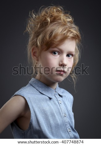 Portrait of beautiful red-haired girls 8 years - stock photo