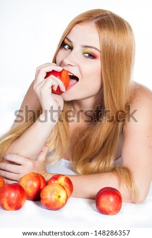 portrait of beautiful red-haired woman with peaches