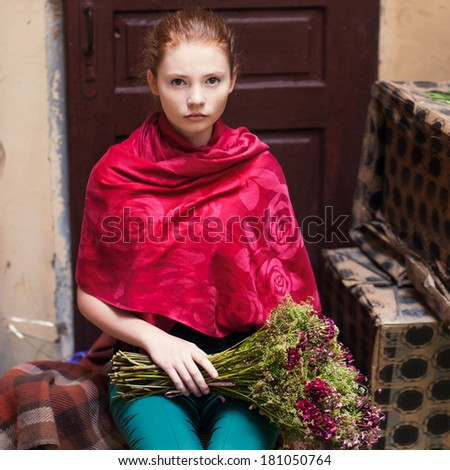 portrait of beautiful redhead girl with flowers - stock photo