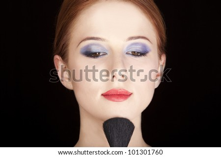 Portrait of beautiful redhead girl with style make-up and brush.
